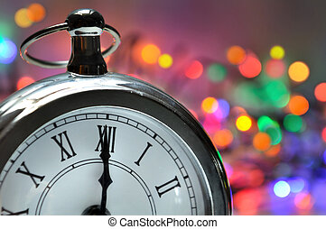 midnight on a clock with a colorful bokeh background