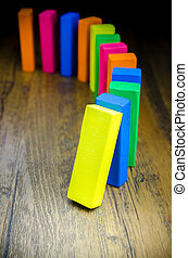 The domino effect of colorful wooden blocks, Selective focus
