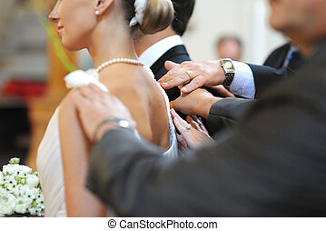 Parents blessing bride and groom during a wedding ceremony