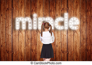 Schoolgirl with singboard word over wood background