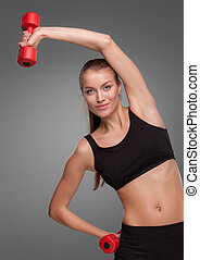 Sporty woman doing aerobic exercise