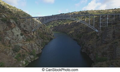 Aerial view under iron bridge over canyon - Under the Pino...