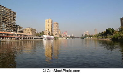 view of Cairo from boat sailing on Nile river
