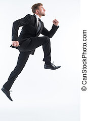 Businessman running up imaginative stairs - Picture of...