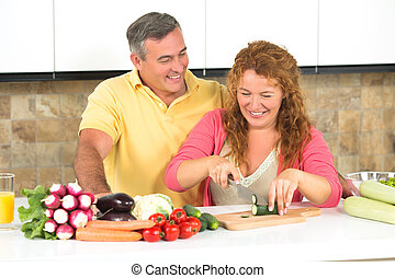 Middle-aged couple in the kitchen