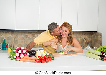 Middle-aged couple in the kitchen - Happy middle-aged man...