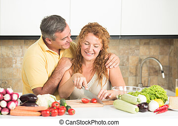 Mature couple in the kitchen - Happy senior couple preparing...