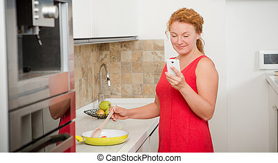 Housewife cooking in the kitchen - Housewife cooking meal...