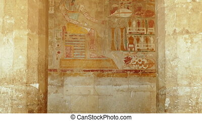 ancient egypt images on wall in luxor - tilt view - ancient...