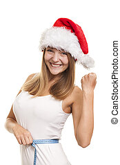 Lose weight for the New Year holiday - Girl in a red Santas...