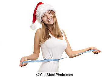 Lose weight for the New Year holiday - Girl in a red Santa's...