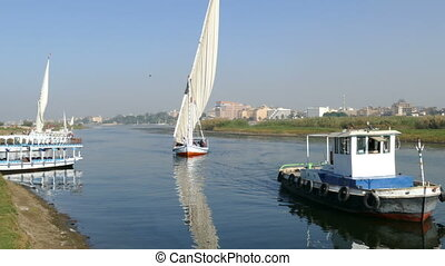 touristic feluca boat on Nile in Luxor, Egypt - CAIRO, EGYPT...