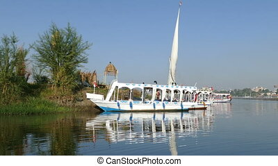boats and ships on Nile river in Luxor, Egypt - CAIRO, EGYPT...