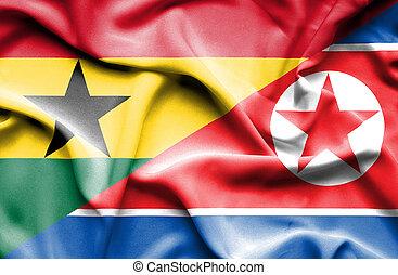 Waving flag of North Korea and Ghana