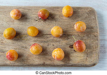 Mirabelle plums - Fresh sweet mirabelle plums on a chopping...