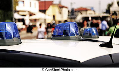 police car while patrolling in the city - Blue sirens of...