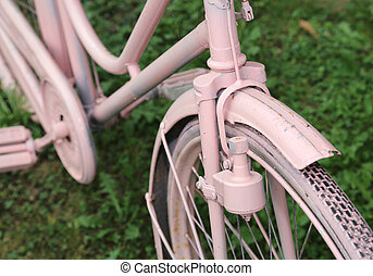 detail of old bicycle with the bottle dynamo on the front...