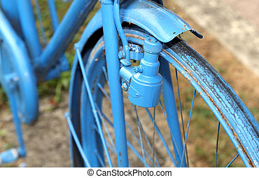 vintage bicycle with the bottle dynamo on the front wheel -...