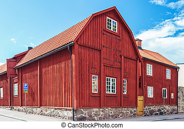 Ancient red wooden house in Karlskrona, Sweden - Ancient red...