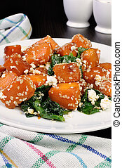 pumpkin with spinach and sesame seeds