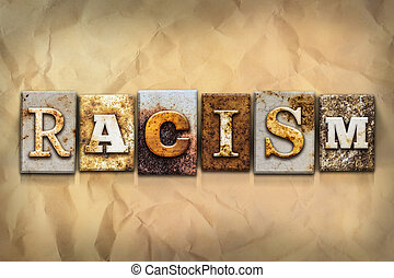 Racism Concept Rusted Metal Type - The word RACISM written...