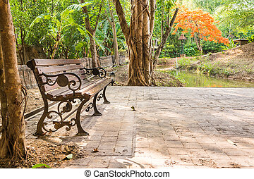 bench in the autumn park - vitage style image of bench in...