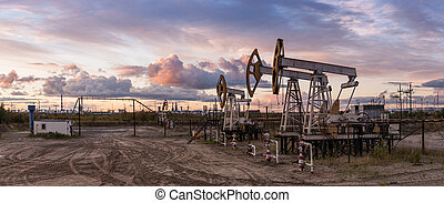 Panoramic oil pumpjack. - Oil and gas industry. Panoramic of...