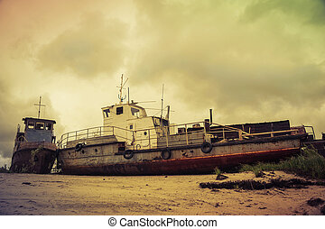 Old broken ships on the coast. - Old wrecked boat on the...