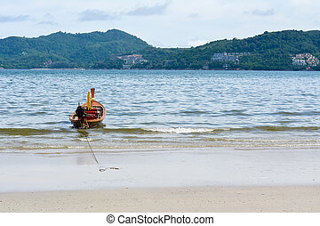 Longtail boat parked at in andaman sea, Thailand