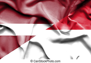 Waving flag of Indonesia and Latvia