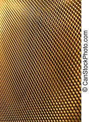 Perforated gold metal grate.
