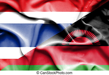 Waving flag of Malawi and Thailand