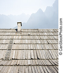 Mountain hut with a  background above the roof.