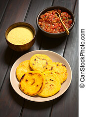 Colombian Arepa with Hogao Sauce - Plate of arepas with...