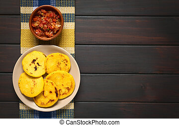 Colombian Arepa with Hogao Sauce - Overhead shot of arepas...