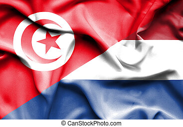 Waving flag of Netherlands and Tunisia
