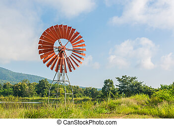 red wind turbine generator
