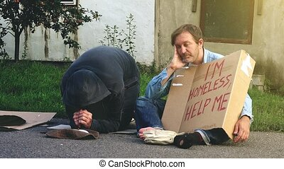 Homeless men on the street - Man on the street giving change...