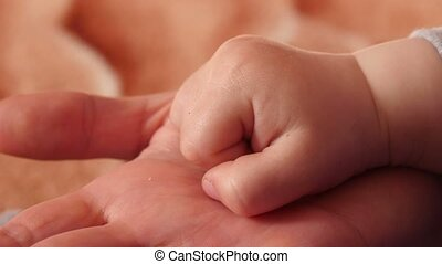 Hands of Mother and Child - Hands mother and son, close up