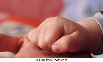 Women Fingers and Thumbs Baby - Hands mother and son, close...