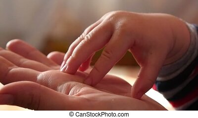 Hands Mother And Son - Hands mother and son, close up