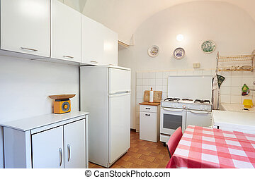 Old kitchen in normal house in Italy