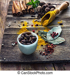 spicy food - Set of different spices on the old wooden...