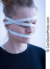 Female with tape-measure - Close up of an anorexic female...