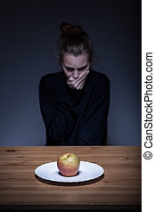 Anorexic having nausea - Image of a lonely anorexic having...