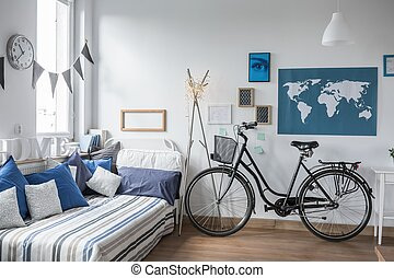 Bike in teenager's room - Urban bike standing in designed...