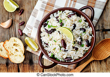 coconut lime rice with red beans and cilantro dark wood...