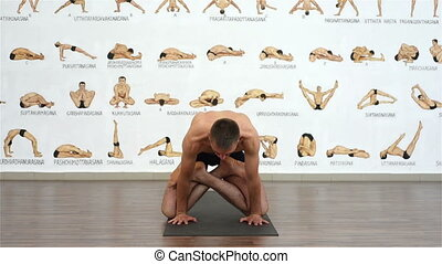 yogi man showing pose - muscular young yogi man showing yoga...