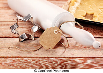 Baking traditional Christmas star cookies with a wooden...