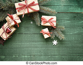 Decorative Christmas gifts tied with red ribbon displayed on...